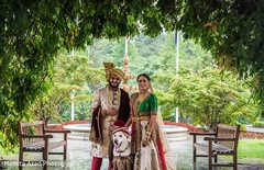 Indian bride and groom posing with pet