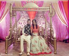 Maharani and raja posing with the decor