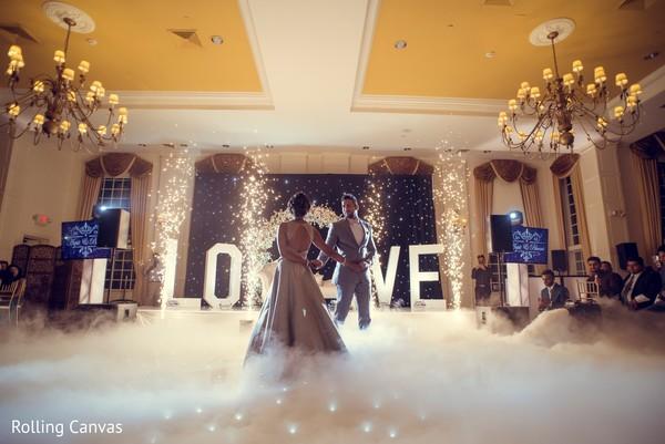 Smoke covers the Indian wedding dance floor