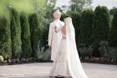 Sweet and lovely Indian bride's and groom's first look scene.