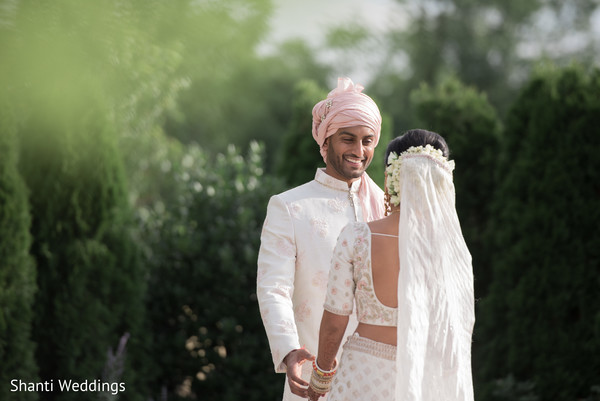 Indian groom smiles as he meets the maharani
