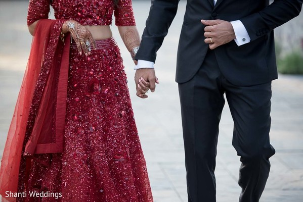 Indian groom and bride wearing their reception attires