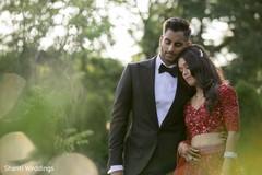 Tender moment between raja and maharani outdoors