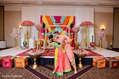 Indian lovebirds at sangeet stage photo session.