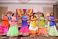 Indian bridesmaids celebrating the sangeet traditional dance.