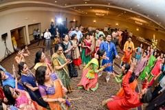 Indian pre-wedding guests celebrating garba dance.