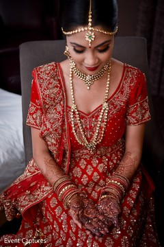 Enchanting Indian bride showing her henna art.