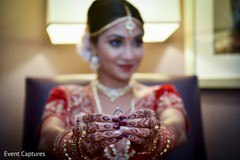 Indian bride showing her engagement ring.
