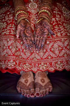 Indian bride capture with her mehndi art finished.