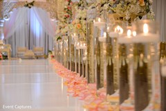 Magnificent Indian wedding aisle candle and petals decor.