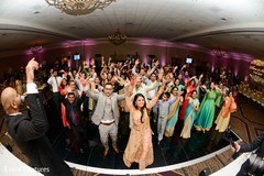 Cheerful indian wedding reception  dance.