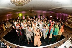 Gleeful indian wedding reception dance performance