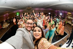 Upbeat Indian wedding reception scene.