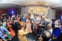 Cheerful Indian wedding guests rocking the dance floor