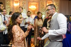 Adorable indian bride and groom showing some dance moves.