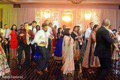 Indian wedding guests showing some dance moves.