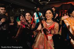 Maharani dancing with Dandiya Sticks.