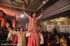 Indian bride and groom enjoying sangeet.