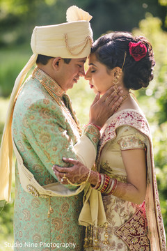 Sweet Indian bride and groom's first look capture.