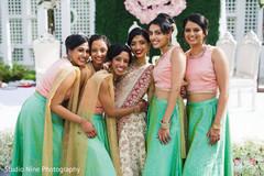 Joyful moment of Indian bride and bridesmaids capture.