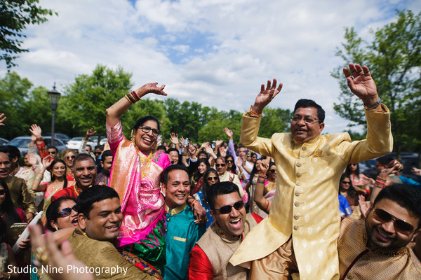 Joyful Indian wedding baraat procession.
