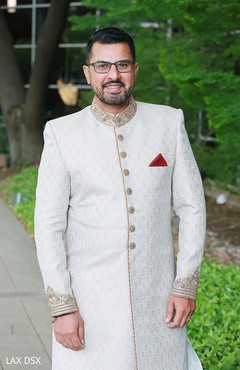Indian groom looking at the camera during pictures