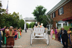 Lovely capture of bride and groom leaving wedding on carriage.