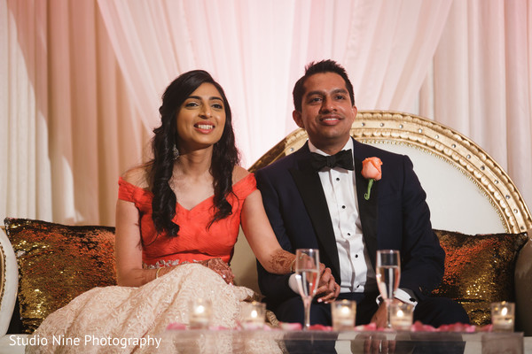 Adorable indian newlyweds at their reception.