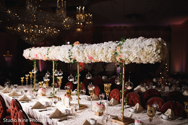 Majestic Indian wedding reception long table flowers decor.