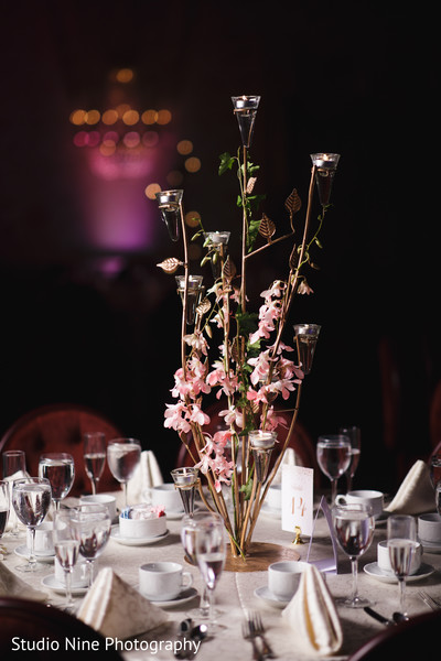 Delightful Indian wedding reception table centerpiece decor.