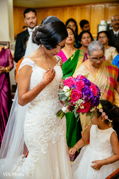 Indian bride making her entrance to the ceremony