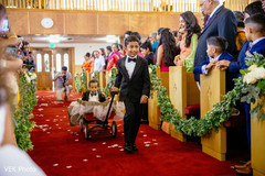 Enchanting kid guests making their entrance to the ceremony