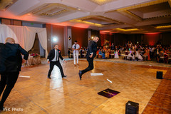 Indian groomsmen showing some moves during the reception