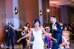 Maharani with wedding gown dancing with raja