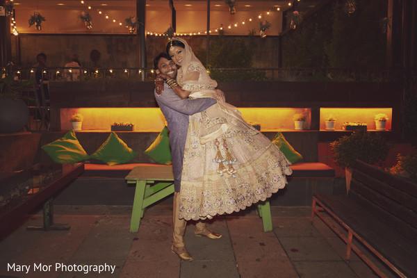 Cheerful Indian newlyweds hug
