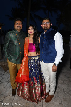 Enchanting Indian bride posing with relatives.