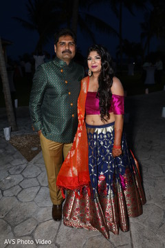 Lovely Indian bride posing with parent.