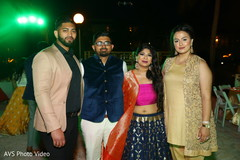 Lovely  Indian couple posing with friends.