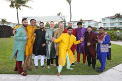Indian groom with groomsmen on their sangeet outfits.