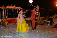Indian bride and bridesmaids performing a sangeet dance.