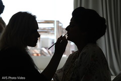 Wonderful silhouette of maharani getting her makeup done.