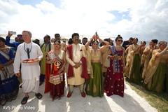 Indian priest, parents at baraat celebration capture.