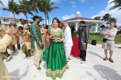 Indian bridesmaid at baraat capture.