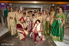 Lovely Indian couple with bridesmaids and groomsmen.