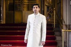 Shot of elegant Indian groom wearing the sherwani
