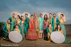 Indian bride, groom, bridesmaids and groomsmen posing for photo shoot.