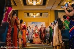 Indian brides entrance to wedding ceremony.