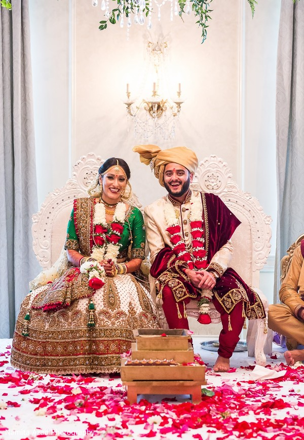 Gorgeous Indian bride and groom looking at camera.