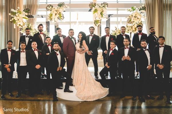 Beautiful shot of Indian newlyweds and groomsmen
