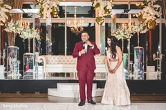 Cheerful Indian couple at the reception